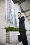 Japanese businessman talks with a mobile phone Stock Photos