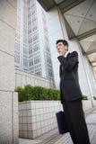 Japanese businessman talks with a mobile phone Stock Photos