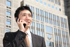 Japanese businessman talks with a mobile phone Stock Photo