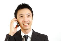 Japanese businessman talks with a smart phone stock images
