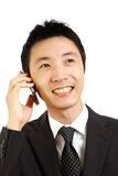 Japanese businessman talks with a smart phone Stock Image