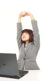 Japanese businesswoman doing stretch Stock Photography