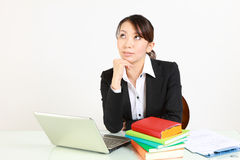 Japanese businesswoman dreaming at her future Royalty Free Stock Photos