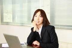 Japanese businesswoman dreaming at her future Royalty Free Stock Image