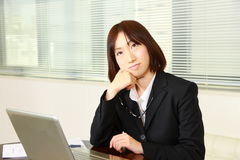 Japanese businesswoman dreaming at her future Royalty Free Stock Images