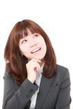 Japanese businesswoman dreaming at her future Stock Photo