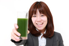Japanese businesswoman with green vegetable juice Royalty Free Stock Images
