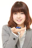 Japanese businesswoman with a miniature car Royalty Free Stock Photos