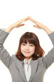 Japanese businesswoman showing OK gesture Royalty Free Stock Image