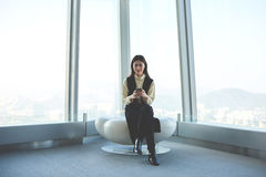 Japanese businesswoman is sitting in contemporary office Stock Photo