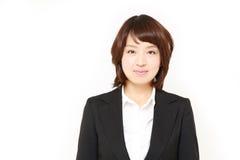 Japanese businesswoman smiles Royalty Free Stock Photo
