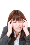 Japanese businesswoman suffers from headache Royalty Free Stock Photo