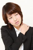 Japanese businesswoman suffers from neck ache Stock Photo