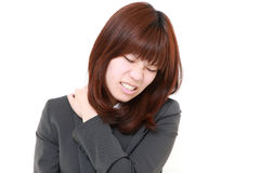 Japanese businesswoman suffers from neck ache Royalty Free Stock Photography