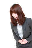 Japanese businesswoman suffers from stomachache Royalty Free Stock Images