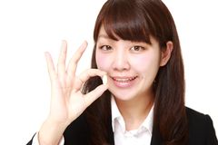 Japanese businesswoman takes a supplement Stock Image