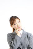 Japanese businesswoman thinks about something Stock Photography