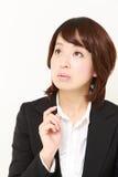 Japanese businesswoman thinks about something Royalty Free Stock Photo