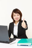 Japanese businesswoman with thumbs up gesture Royalty Free Stock Images