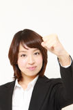 Japanese businesswoman in a victory pose Royalty Free Stock Image