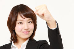 Japanese businesswoman in a victory pose Royalty Free Stock Photo