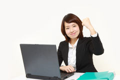 Japanese businesswoman in a victory pose Stock Photo