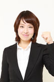 Japanese businesswoman in a victory pose Stock Image