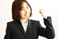 Japanese businesswoman in a victory pose Royalty Free Stock Photography