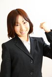 Japanese businesswoman in a victory pose Stock Images