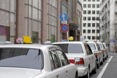 Japanese cabs. In a row in a small crowded city street Stock Image