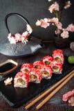 Japanese California Roll with salmon, avocado, cucumber, cream with Philadelphia cheese, tobiko caviar Sushi menu. royalty free stock images