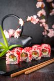 Japanese California Roll with salmon, avocado, cucumber, cream with Philadelphia cheese, tobiko caviar Sushi menu. stock images