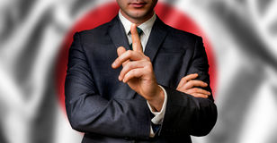 Japanese candidate speaks to the people crowd. With one finger on lips - election in Japan stock photo