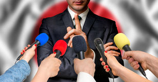 Japanese candidate speaks to reporters - journalism concept Stock Photography