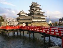 Japanese Castle. Matsumoto Castle in the Japanese Alps during Cherry Blossom (Sakura stock image