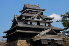 Japanese castle with blue sky background Royalty Free Stock Images