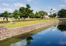 Japanese castle with moat and white tower Stock Photography