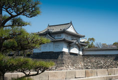 Japanese castle in Osaka. MWS: The guardhouse sits atop the castle walls of the Osaka castle in Japan.  Very typical of Japanese architecture of the period Stock Photography