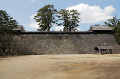 Japanese castle stone wall and courtyard Stock Photos