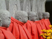 Japanese Cemetery. Guardian stone figures at a shrine in Kyoto, Japan Royalty Free Stock Images