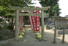 Japanese Cemetery with Torii and Banners Royalty Free Stock Images