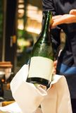 Japanese champagne in the hands of the waiter Tokyo, Japan. Vertical. Frame for text. Japanese champagne in the hands of the waiter Tokyo, Japan. Vertical royalty free stock photography