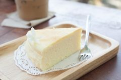 Japanese cheese cake on wooden plate Royalty Free Stock Image