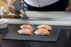 Japanese chef making salmon sushi Royalty Free Stock Photos