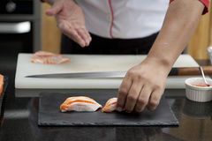 Japanese chef making salmon sushi. Japanese food Stock Photo