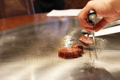 Japanese chef preparing Kobe beef at a restaurant Stock Photos