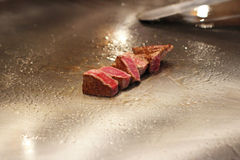 Japanese chef preparing Kobe beef at a restaurant Royalty Free Stock Photo