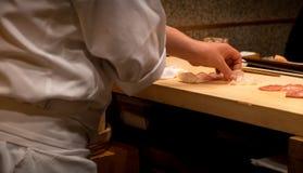 Japanese chef preparing sushi Stock Images