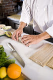 Japanese chef in restaurant making sushi roll Stock Photography