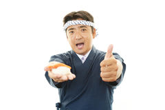 Japanese chef showing thumbs up sign Stock Photos